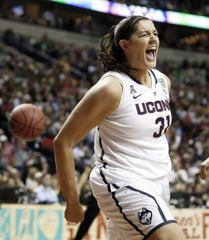Connecticut center Stefanie Dolson (31) celebrates her basket against Notre Dame during the second half of the championship game in the Final Four of the NCAA women's college basketball tournament, Tuesday, April 8, 2014, in Nashville, Tenn. (AP Photo/John Bazemore) Photo: AP