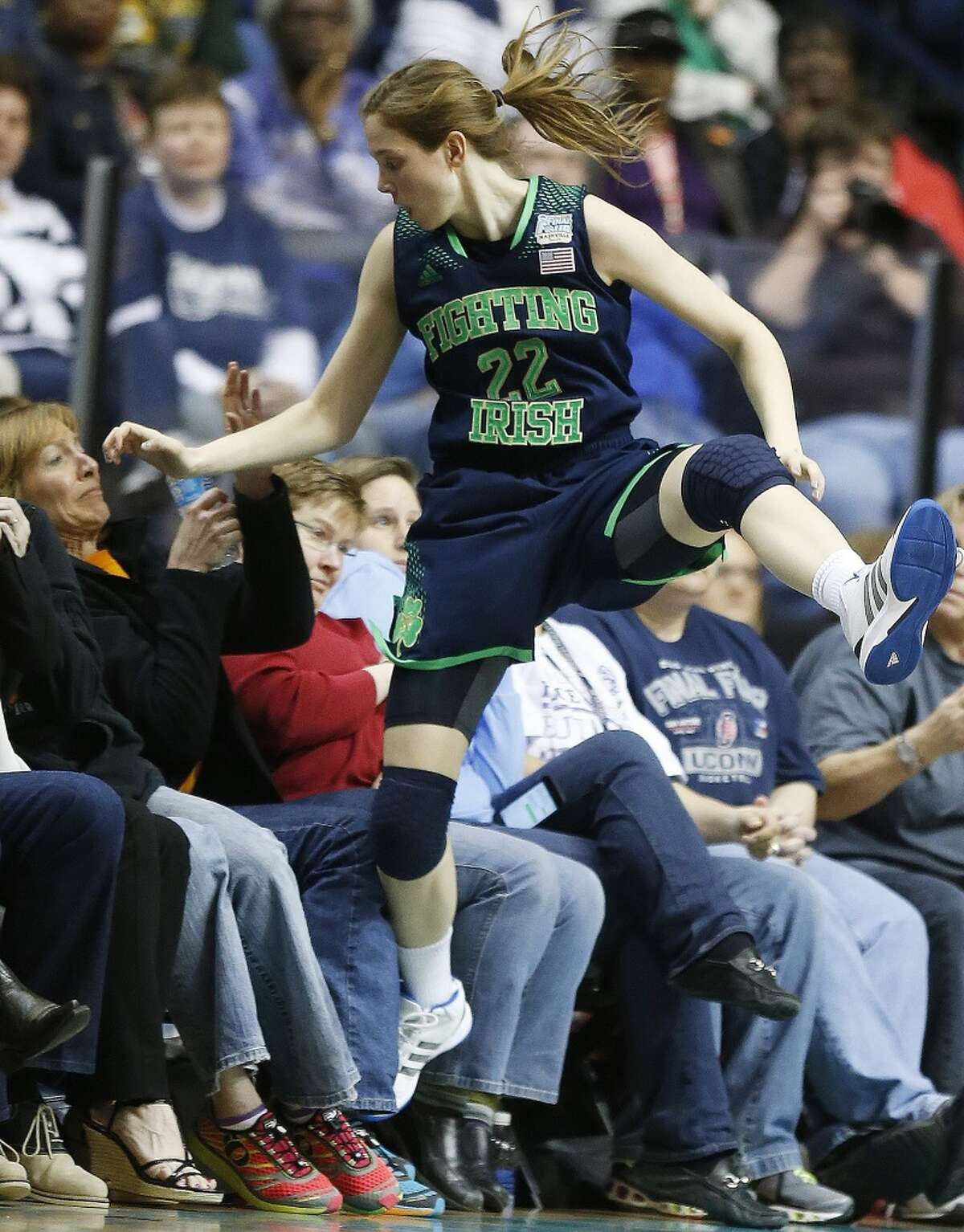 Notre Dame guard Madison Cable (22) flies off court during the second half of the championship game against Connecticut in the Final Four of the NCAA women's college basketball tournament, Tuesday, April 8, 2014, in Nashville, Tenn.(AP Photo/John Bazemore)