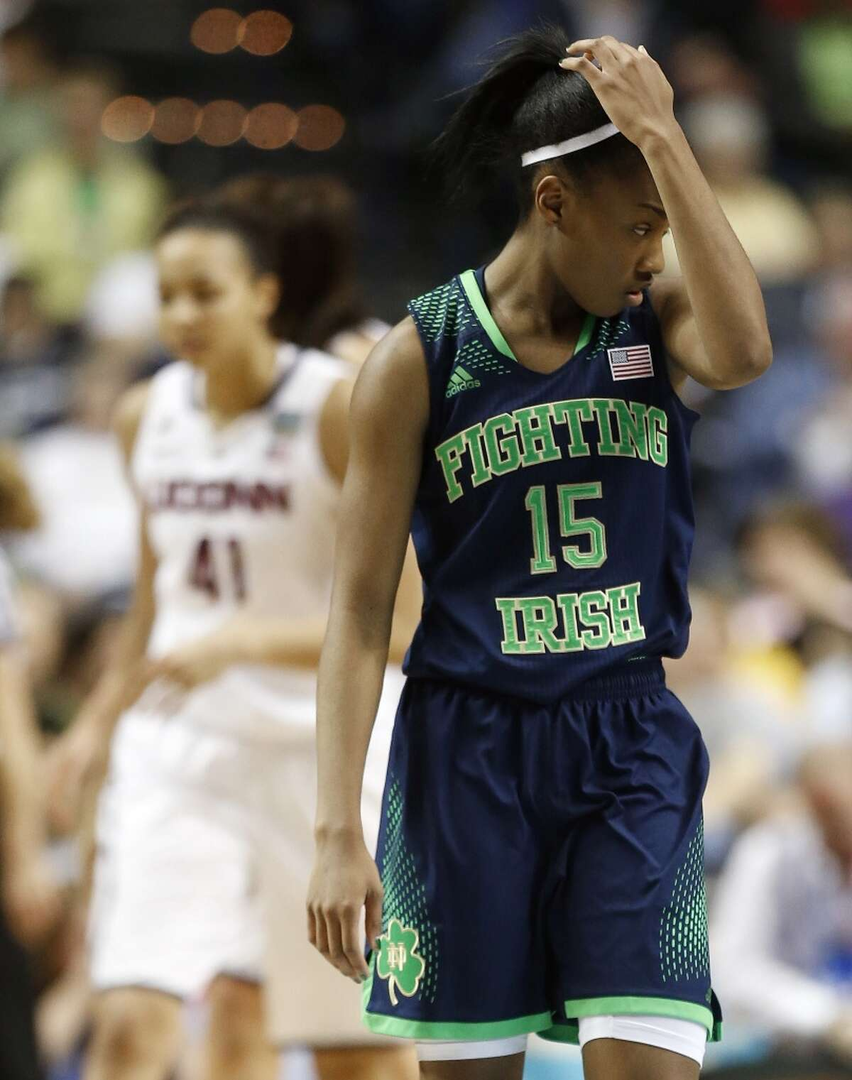 Notre Dame guard Lindsay Allen (15) walks off the court during the second half of the championship game against Connecticut in the Final Four of the NCAA women's college basketball tournament, Tuesday, April 8, 2014, in Nashville, Tenn. (AP Photo/John Bazemore)