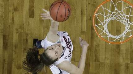 Connecticut forward Breanna Stewart (30) shoots against Notre Dame guard Kayla McBride (21) during the second half of the championship game in the Final Four of the NCAA women's college basketball tournament, Tuesday, April 8, 2014, in Nashville, Tenn. (AP Photo/Mark Humphrey)