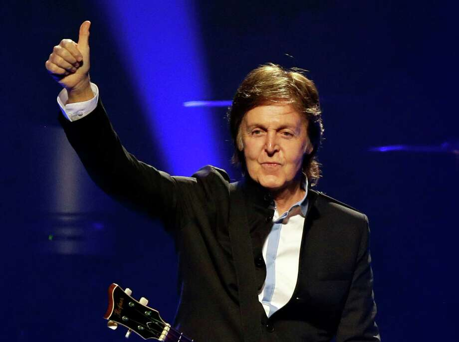 "FILE - In this May 18, 2013 file photo, Paul McCartney performs during the first U.S concert of his ""Out There!"" world tour in Orlando, Fla.McCartney will perform at the iHeartRadio music festival in Las Vegas next month. Clear Channel said Wednesday, Aug. 14, that the former Beatle will perform on the second night of the two-day festival, which kicks off Sept. 20. He joins a list of top performers, including Justin Timberlake, Elton John, Katy Perry, Bruno Mars and Drake. (AP Photo/John Raoux, File) ORG XMIT: NYET230 Photo: John Raoux / AP"