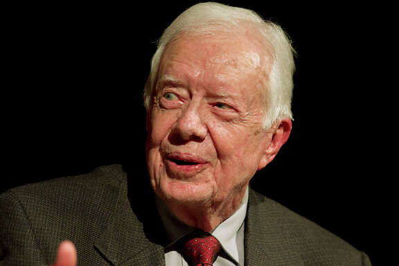"Former President Jimmy Carter tells the summit, ""Too many people are at ease with the still-existing disparity."""