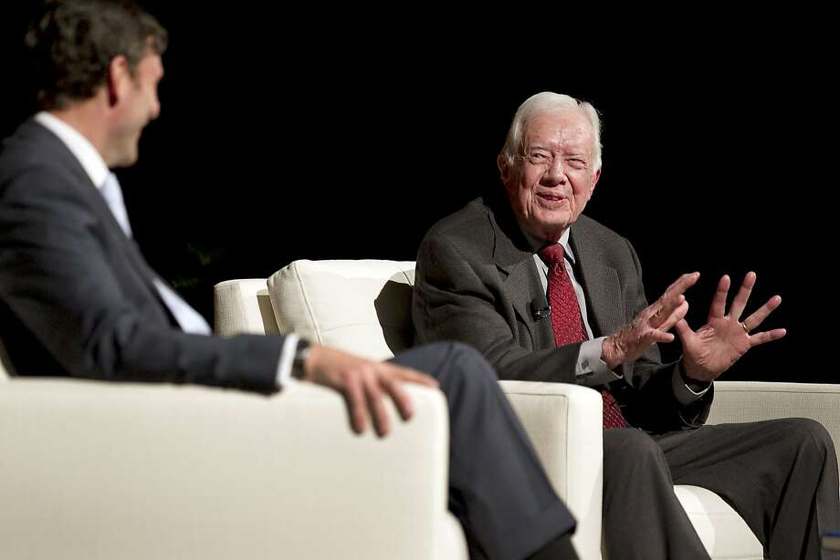 Former President Jimmy Carter (right) speaks with Mark Updegrove, director of the Lyndon B. Johnson Presidential Library, at an event in Austin, Texas. Photo: Ralph Barrera, Associated Press