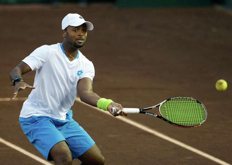 Donald Young (USA) returns a shot against Bob Bryan and Mike Bryan (USA) on April 8, 2014 at the U.S. Men's Clay Court Championship at River Oaks in Houston, TX. Bryan brothers won 6-3, 6-4. Photo: Thomas B. Shea, For The Chronicle / © 2014 Thomas B. Shea