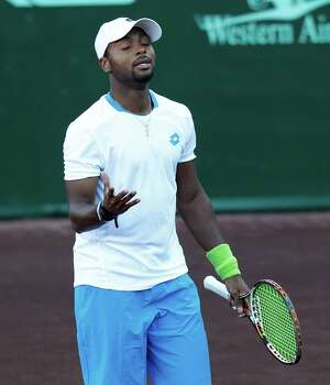 Donald Young (USA) is upset with himself after hitting the net on a return shot against  Bob Bryan and Mike Bryan (USA) on April 8, 2014 at the U.S. Men's Clay Court Championship at River Oaks in Houston, TX. Bryan brothers won 6-3, 6-4. Photo: Thomas B. Shea, For The Chronicle / © 2014 Thomas B. Shea