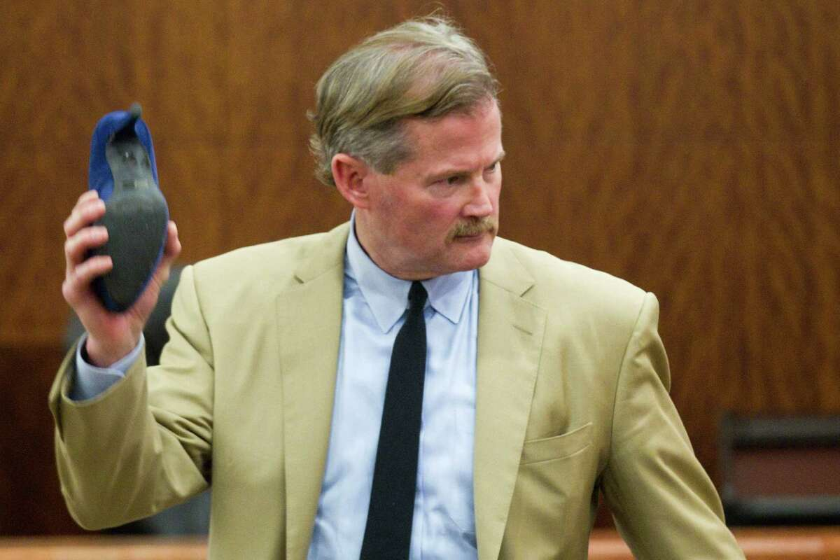 Defense attorney Jack Carroll holds the murder weapon as he gives his closing argument in the trial of Ana Lilia Trujillo on Tuesday.