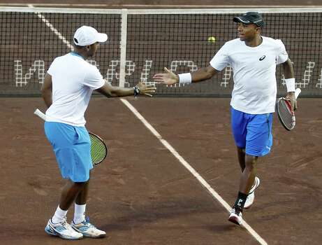 Nicholas Monroe and Donald Young (USA) celebrate a point against  Bob Bryan and Mike Bryan (USA) on April 8, 2014 at the U.S. Men's Clay Court Championship at River Oaks in Houston, TX. Bryan brothers won 6-3, 6-4. Photo: Thomas B. Shea, For The Chronicle / © 2014 Thomas B. Shea