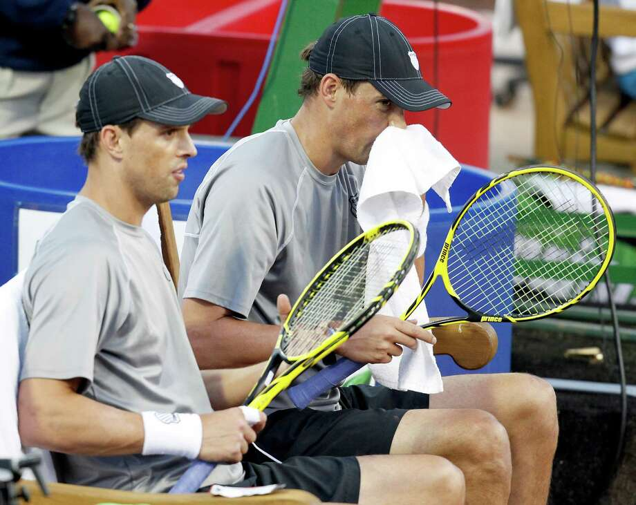 Bob Bryan and Mike Bryan (USA) between games sit on the bench resting before playing against Nicholas Monroe and Donald Young (USA) on April 8, 2014 at the U.S. Men's Clay Court Championship at River Oaks in Houston, TX. Bryan brothers won 6-3, 6-4. Photo: Thomas B. Shea, For The Chronicle / © 2014 Thomas B. Shea