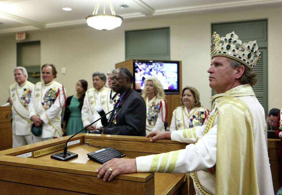 El Rey Feo LXVI Jimmy Green listens to a proclamation honoring the scholarship organization he leads this year. / ©2013 San Antonio Express-News