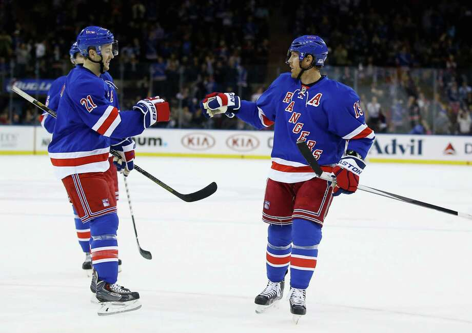 NEW YORK, NY - APRIL 08:  Brad Richards #19 of the New York Rangers celebrates his goal with Derek Stepan #21 of the New York Rangers during their game against the Carolina Hurricanes at Madison Square Garden on April 8, 2014 in New York City.  (Photo by Al Bello/Getty Images) ORG XMIT: 181116483 Photo: Al Bello / 2014 Getty Images