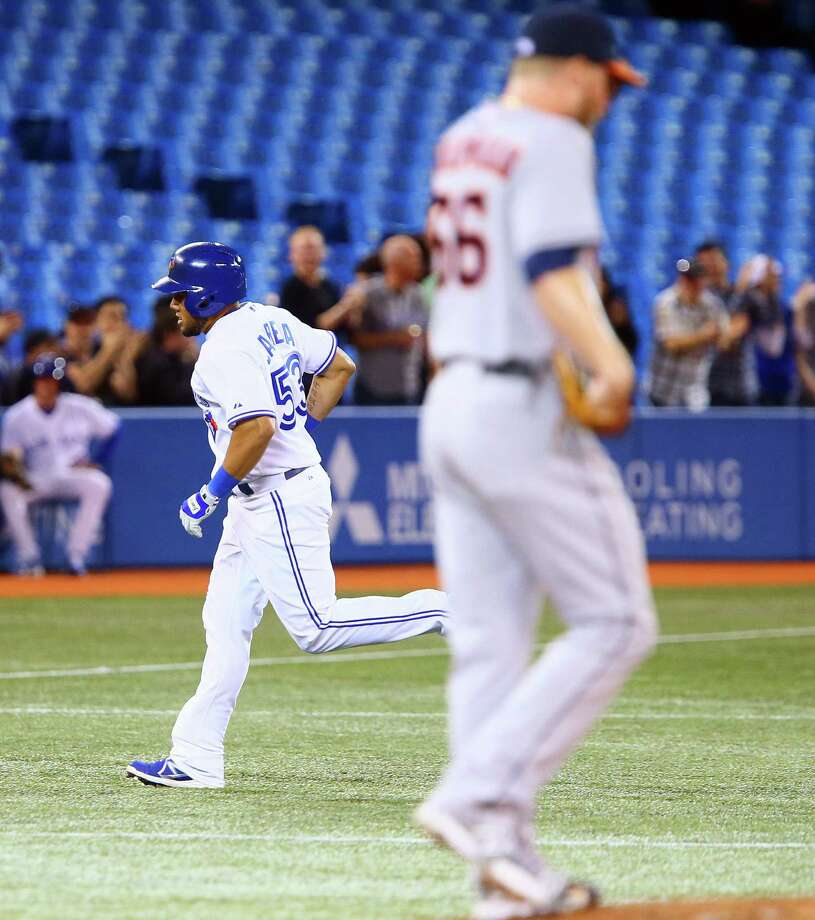 Toronto's Melky Cabrera approaches third base after hitting a two-run homer off Houston's Kevin Chapman in the seventh inning. Cabrera has homered in each of his last four games. Photo: Getty Images / 2014 Getty Images