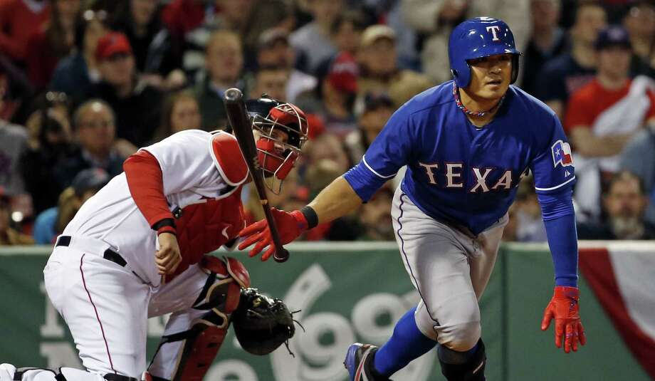 Texas' Shin-Soo Choo flips his bat aside after connecting for an RBI double in the fifth inning of the Rangers' victory in Boston. Photo: Elise Amendola / Associated Press / AP