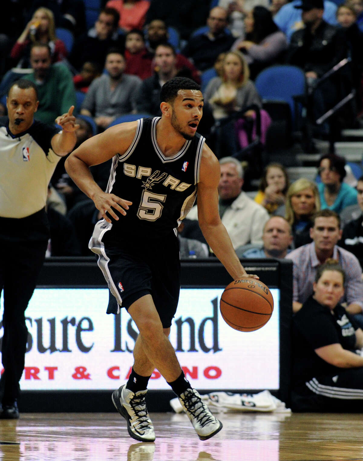 San Antonio Spurs guard Cory Joseph (5) dribbles in an NBA basketball game against the Minnesota Timberwolves at the Target Center on in Minneapolis on Tuesday, April 8, 2014. (AP Photo/Hannah Foslien)