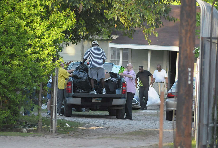 Residents are assisted in moving out of their halfway house at 9330 West Montgomery Road on Tuesday. Photo: Â Tony Bullard 2014, Freelance Photographer / © Tony Bullard & the Houston Chronicle
