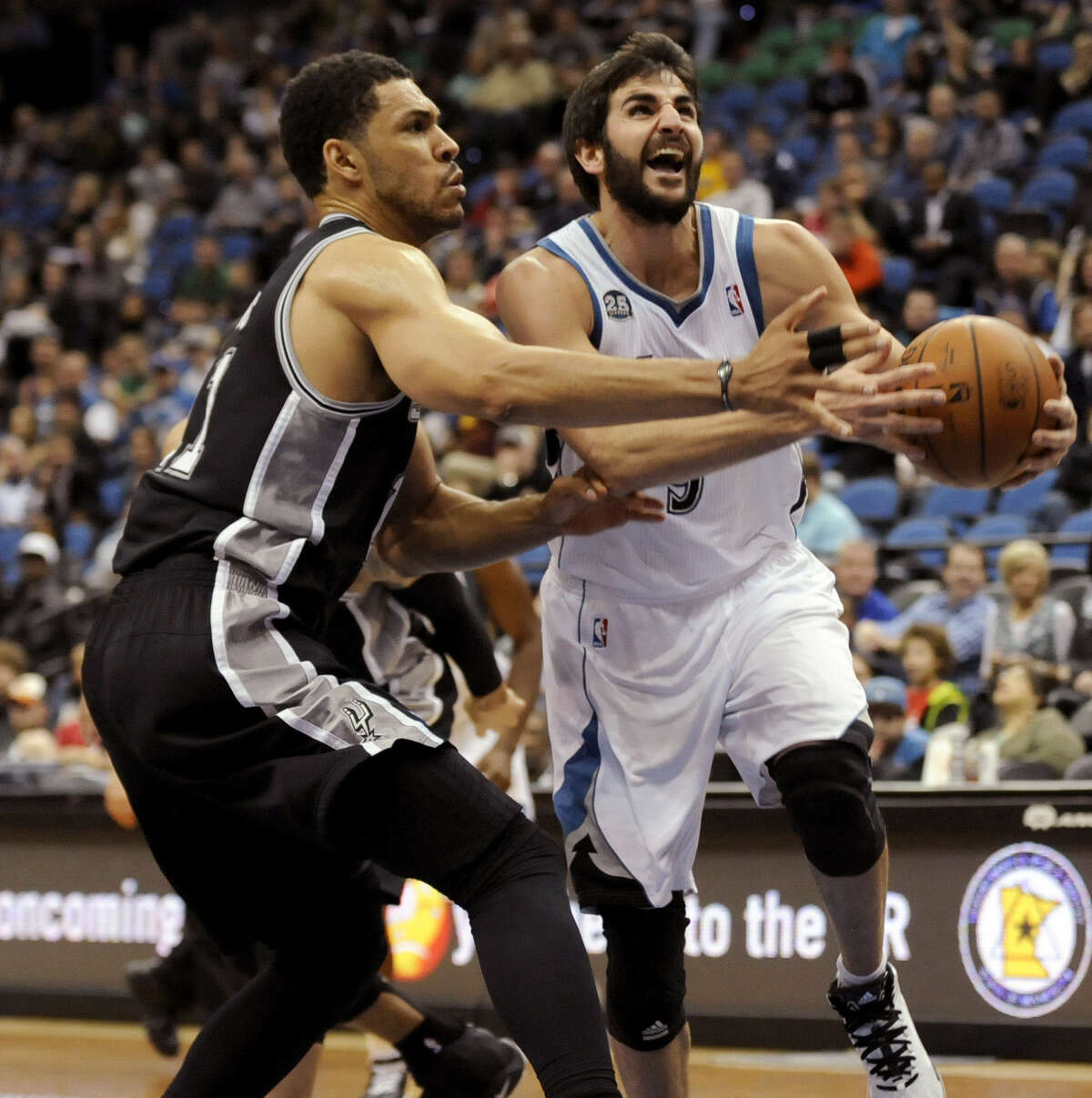 Timberwolves point guard Ricky Rubio (right) prepares to shoot against Spurs forward Jeff Ayres at Minneapolis' Target Center.