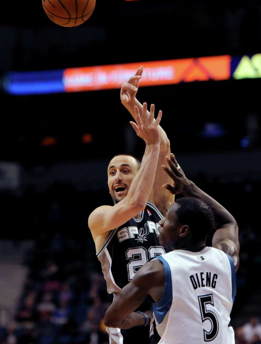 San Antonio Spurs' Tiago Splitter, from Brazil, passes over Minnesota Timberwolves' Gorgui Dieng (5) during the second quarter in an NBA basketball game at the Target Center in Minneapolis on Tuesday, April 8, 2014. (AP Photo/Hannah Foslien)