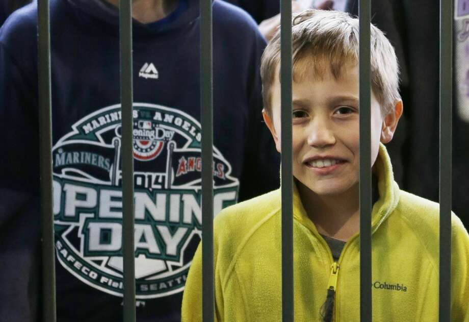Kein Carpenter, 12, of Denton, Mont., is first in line outside one of the home-plate gates at Safeco Field, Tuesday, April 8, 2014, in Seattle, before the Seattle Mariners' home-opener baseball game against the Los Angeles Angels. (AP Photo/Ted S. Warren) Photo: Ted S. Warren, AP