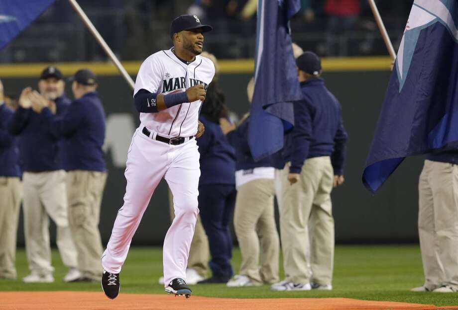 Seattle Mariners second baseman Robinson Cano runs on the red carpet during player introductions, Tuesday, April 8, 2014, before the Seattle Mariners' home-opener baseball game against the Los Angeles Angels in Seattle. (AP Photo/Ted S. Warren) Photo: Ted S. Warren, AP