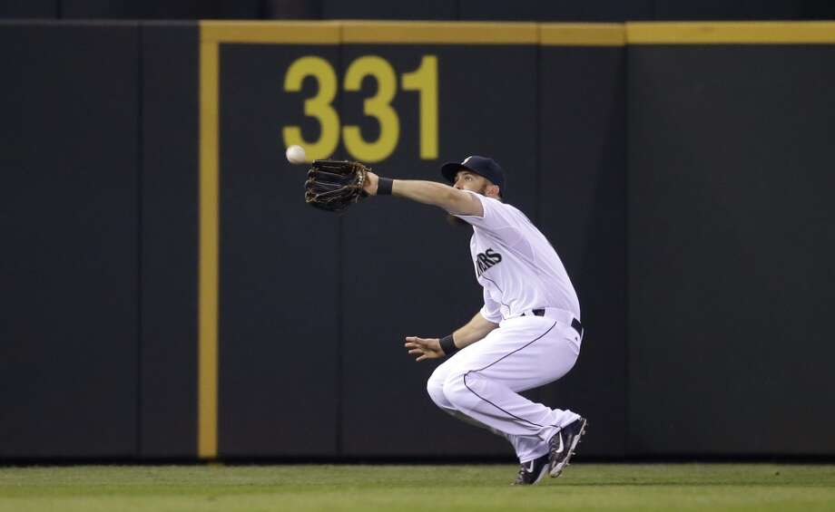 Seattle Mariners' Dustin Ackley in action against the Los Angeles Angels during a baseball game Tuesday, April 8, 2014, in Seattle. (AP Photo/Elaine Thompson) Photo: Elaine Thompson, AP