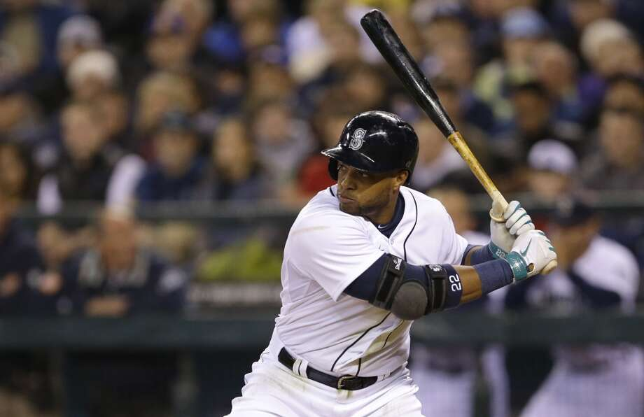 Seattle Mariners' Robinson Cano begins his swing Tuesday, April 8, 2014, in the first inning of the Mariners' home opener baseball game against the Los Angeles Angels in Seattle. Cano grounded into a double play. (AP Photo/Ted S. Warren) Photo: Ted S. Warren, AP