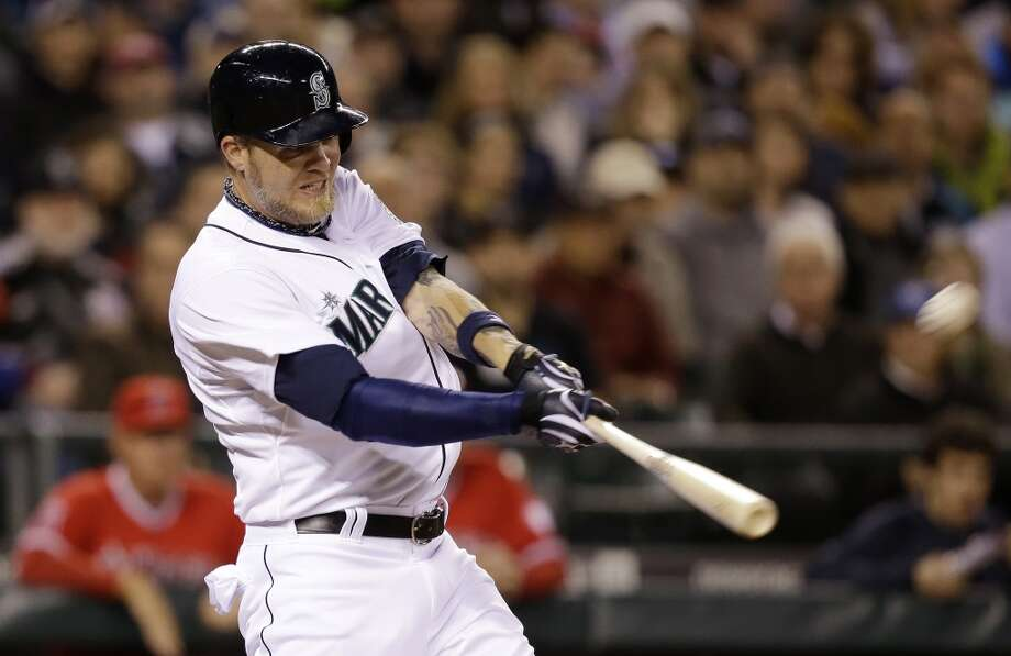 Seattle Mariners' Corey Hart swings on a three-run home run against the Los Angeles Angels in the third inning of a baseball game Tuesday, April 8, 2014, in Seattle. (AP Photo/Elaine Thompson) Photo: Elaine Thompson, AP