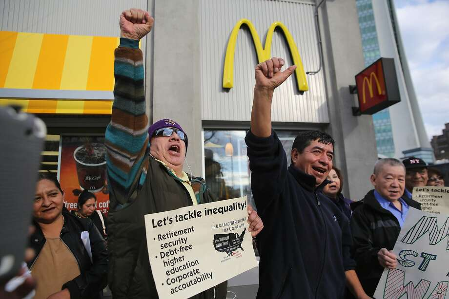 STAMFORD, CT - APRIL 08:  Activists chant for higher wages outside a McDonald's restaurant on April 8, 2014 in Stamford, Connecticut. Demonstrations were organized across the state by Connecticut Working Families to bring attention to minumum wages paid by fast food chains and Wal-Mart stores.  (Photo by John Moore/Getty Images) Photo: John Moore, Getty Images