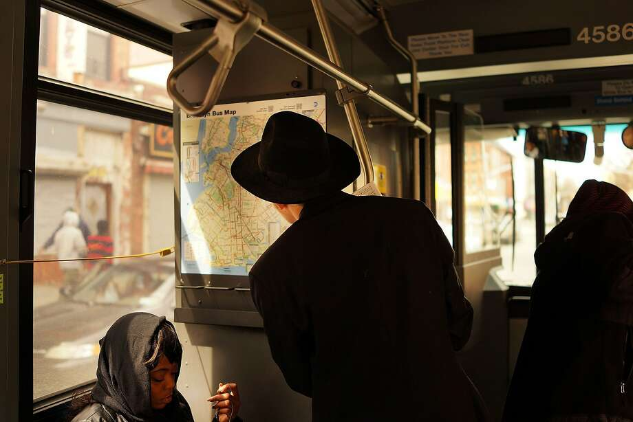 NEW YORK, NY - APRIL 08:  A man looks at the map for the B46 bus on April 8, 2014 in the Brooklyn borough of New York City. The B46 bus, which runs through parts of Crown Heights, Bedford-Stuyvesant and East Flatbush in Brooklyn, is known as New York City's most dangerous and crime ridden bus route. Measured in the number of fare evasions and assaults on drivers and passengers, B46 stands alone. In the latest incident on February 26th, two police officers attempted to arrest a B46 fare beater, who then ran away and shot at them with a pistol as they gave chase. One officer was wounded in the incident.  (Photo by Spencer Platt/Getty Images) Photo: Spencer Platt, Getty Images