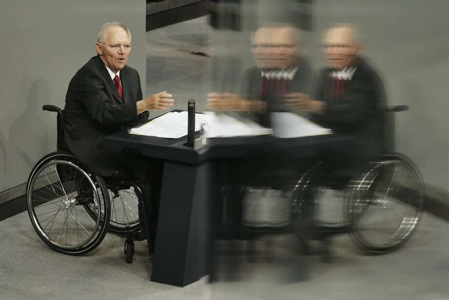 German Finance Minister Wolfgang Schaeuble delivers his speech during the first day of the debate on the German budget for 2014 in Berlin, Germany, Tuesday, April 8, 2014. During a four-day debate the German parliament will discuss the budget plans for the running year. The reflections are caused by windows at the visitors tribune. (AP Photo/Markus Schreiber) Photo: Markus Schreiber, Associated Press