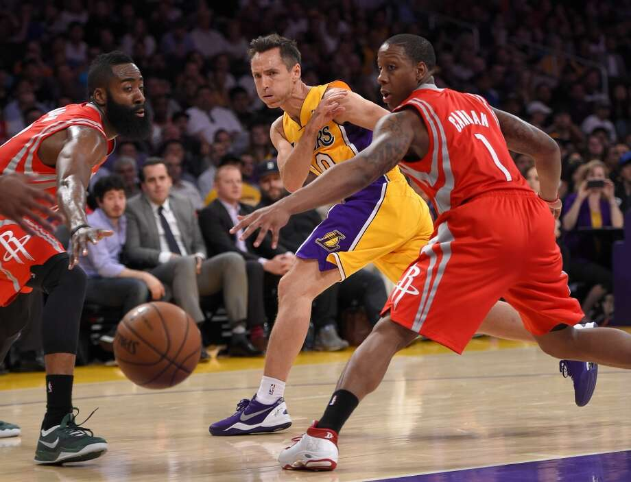April 8: Rockets 145, Lakers 130  Lakers point guard Steve Nash passes between Rockets shooting guard James Harden and point guard Isaiah Canaan. Photo: Mark J. Terrill, Associated Press