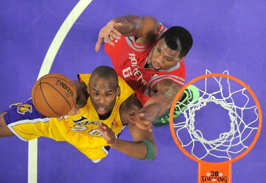 Jodie Meeks of the Lakers attempts a shot against Rockets forward Terrence Jones. Photo: Mark J. Terrill, Associated Press