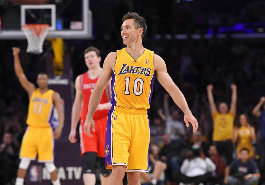 Lakers point guard Steve Nash reacts after becoming No. 3 on the NBA's all-time list for assists. Photo: Mark J. Terrill, Associated Press
