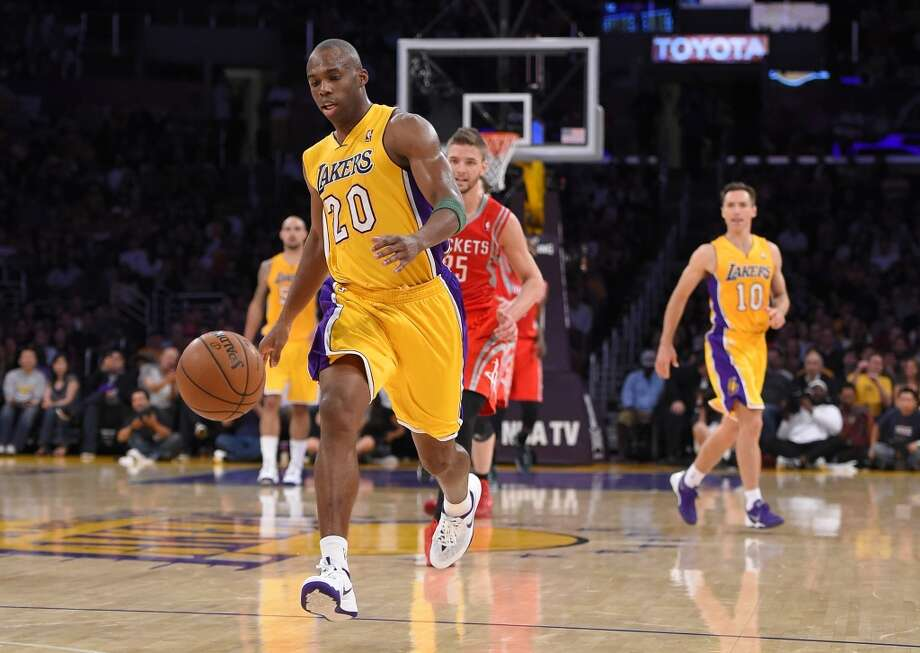 Lakers guard Jodie Meeks breaks away from the Rockets. Photo: Mark J. Terrill, Associated Press