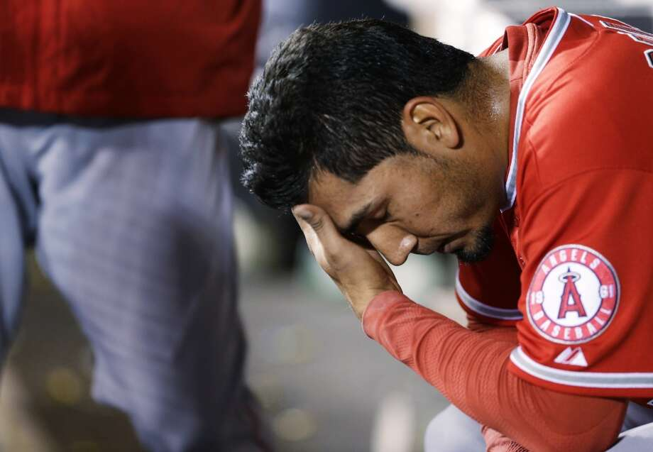 Los Angeles Angels pitcher Fernando Salas sits in the dugout after he was pulled in the seventh inning of a baseball game after giving up a solo home run to Seattle Mariners' Corey Hart, Tuesday, April 8, 2014, in Seattle. (AP Photo/Ted S. Warren) Photo: Ted S. Warren, AP