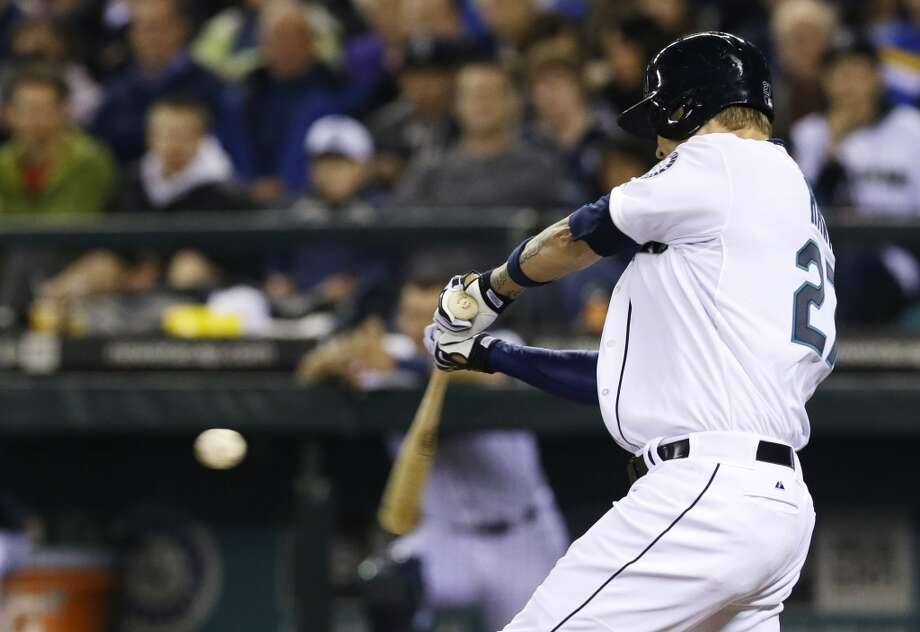 Seattle Mariners' Corey Hart hits a solo home run in the seventh inning of a baseball game against the Los Angeles Angels Tuesday, April 8, 2014, in Seattle. It was his second home run of the game. (AP Photo/Ted S. Warren) Photo: Ted S. Warren, AP
