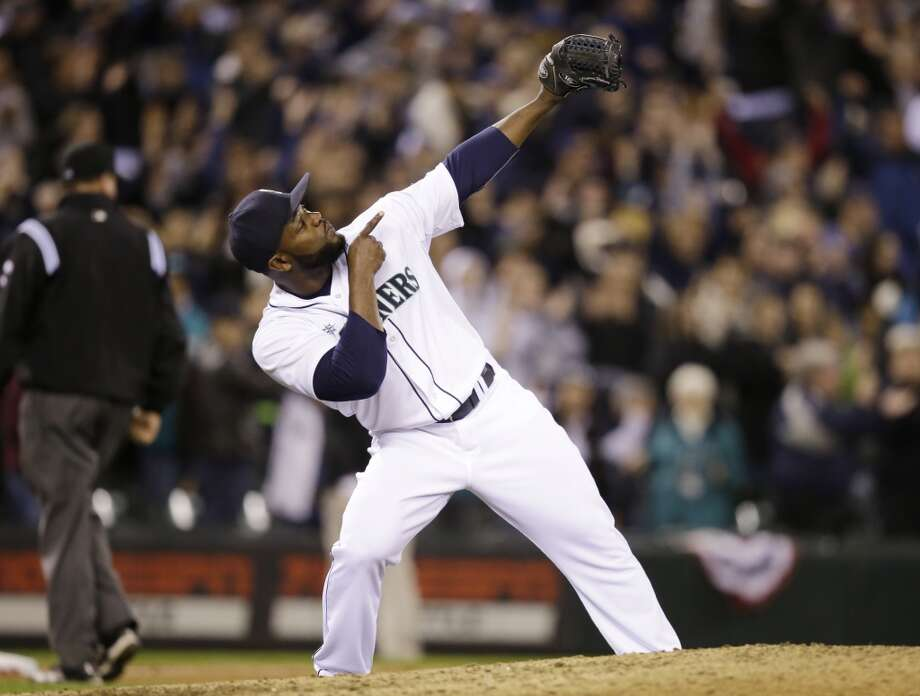 Seattle Mariners closing pitcher Fernando Rodney reacts to the final out of a baseball game against the Los Angeles Angels on Tuesday, April 8, 2014, in Seattle. The Mariners won 5-3. (AP Photo/Elaine Thompson) Photo: Elaine Thompson, ASSOCIATED PRESS
