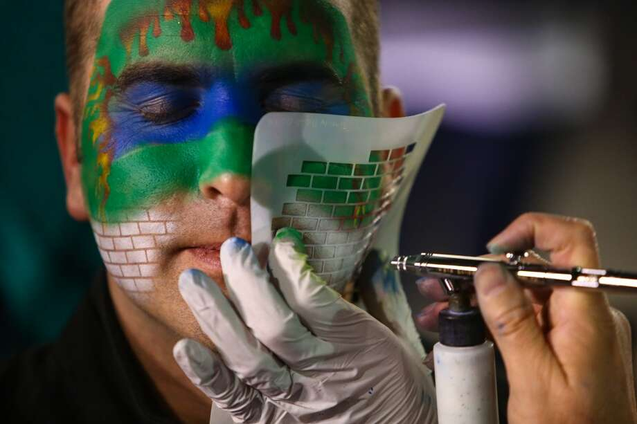 Matt Garvey has his face painted during the Seattle Mariners home opener on Tuesday, April 8, 2014 at Safeco Field. The Mariners defeated the Los Angeles Angels 5-3. (Joshua Trujillo, seattlepi.com) Photo: JOSHUA TRUJILLO, SEATTLEPI.COM