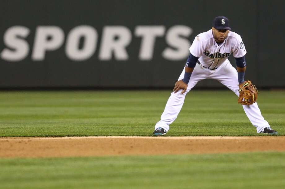 Mariners player Robinson Cano takes his position during the Seattle Mariners home opener on Tuesday, April 8, 2014 at Safeco Field. The Mariners defeated the Los Angeles Angels 5-3. (Joshua Trujillo, seattlepi.com) Photo: SEATTLEPI.COM