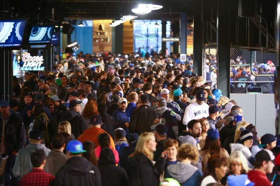 Fans gather on the main concourse during the Seattle Mariners home opener on Tuesday, April 8, 2014 at Safeco Field. The Mariners defeated the Los Angeles Angels 5-3. (Joshua Trujillo, seattlepi.com) Photo: SEATTLEPI.COM