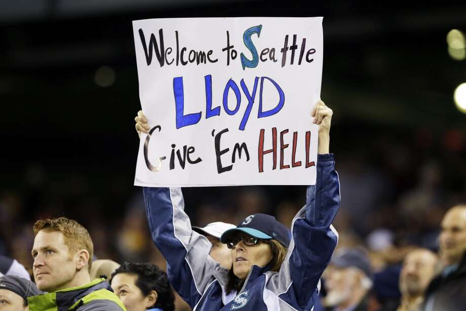 A fan holds a sign supporting new Seattle Mariners manager Lloyd McClendon during the Mariners' baseball game against the Los Angeles Angels, Tuesday, April 8, 2014, in Seattle. (AP Photo/Ted S. Warren) Photo: AP