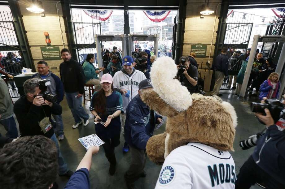 Moose, the Seattle Mariners mascot, greets fans after the gates opened, Tuesday, April 8, 2014, for the Mariners' home-opener baseball game against the Los Angeles Angels in Seattle. (AP Photo/Ted S. Warren) Photo: AP