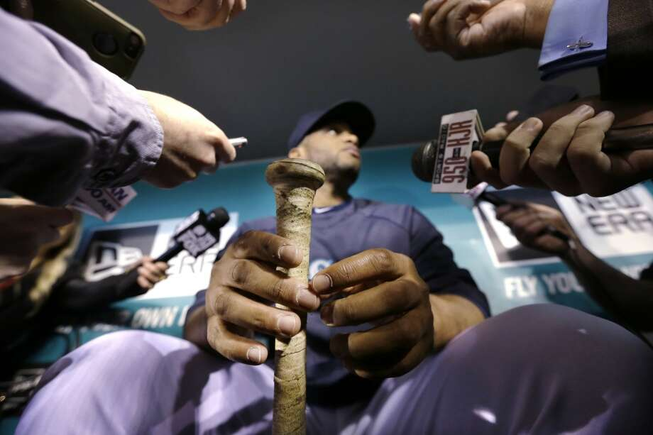 Seattle Mariners' Robinson Cano holds his bat while being interviewed before the baseball team's home opener against the Los Angeles Angels, Tuesday, April 8, 2014, in Seattle. (AP Photo/Elaine Thompson) Photo: AP