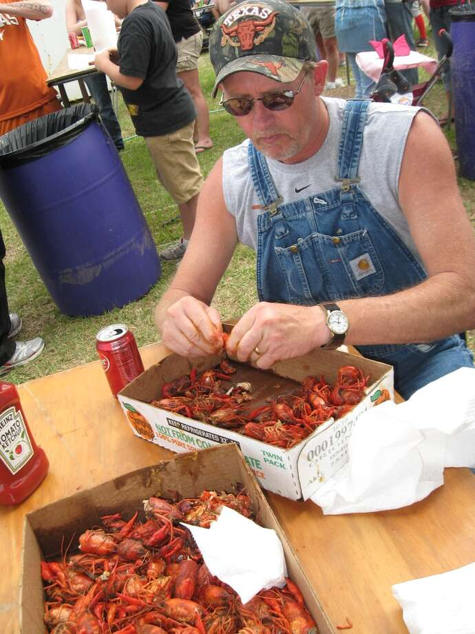 Bill Milner of Evadale enjoys a hot batch of crawfish at the Mauriceville Crawfish Festival. The festival is in its 30th year and runs through Sunday. Heather Nolan/The Enterprise