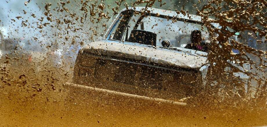 Trucks compete in timed events during the Hardin County Muddin' Music Fest in Kountze, Saturday. Tammy McKinley/The Enterprise