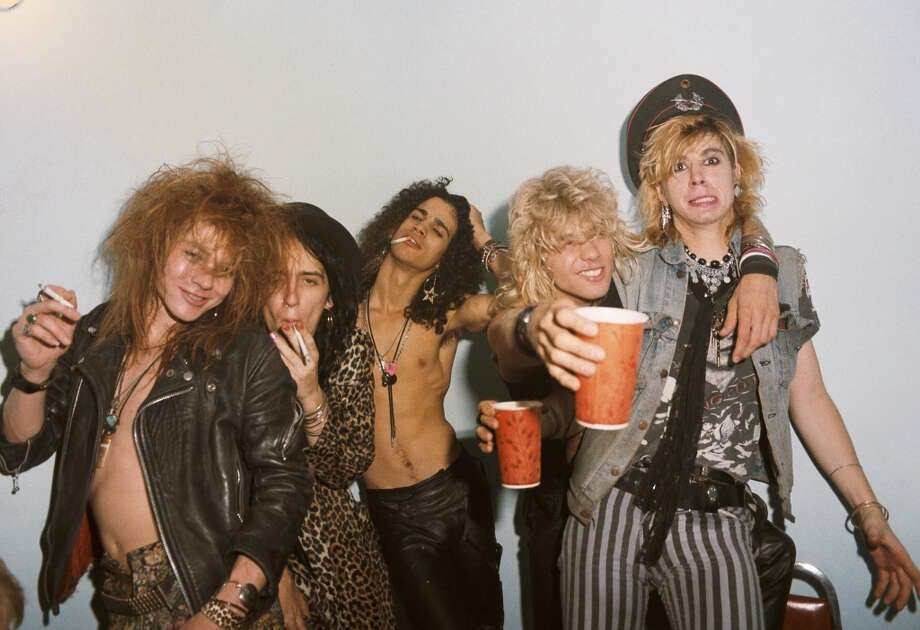 """Guns N' Roses:This was never a stable band — drummer Steven Adler was fired for drug use, guitarist Izzy Stradlin quit after singer Axl Rose went off on audience members during live shows — but things got really bad once Slash got mad. When Rose replaced Slash's guitar track on a cover of """"Sympathy for the Devil,"""" Slash quit. The two have been at odds ever since, with Rose saying that Slash is a """"cancer, better removed and avoided"""" (his statement came shortly after Slash lost his mom to cancer), and Slash reuniting the band in 2012 sans Rose at the Rock and Roll Hall of Fame induction ceremony. Photo: Jack Lue/Marc S Canter, Michael Ochs Archive/Getty Images"""