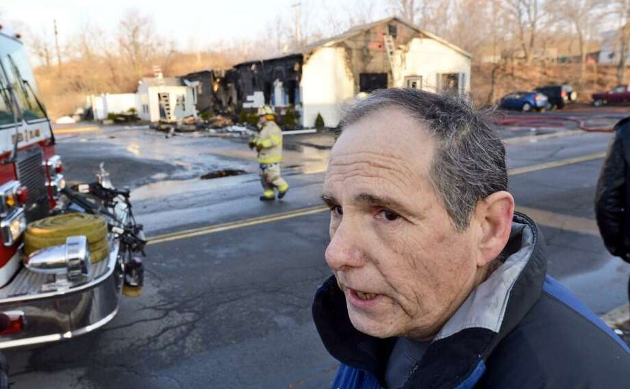 Tom Sweeney, owner of Matt's Fish Fry, talks about his business as firefighters tend the site of an early morning fire that comsumed the Cohoes restaurant on Wednesday, April 9, 2014. (Skip Dickstein / Times Union)