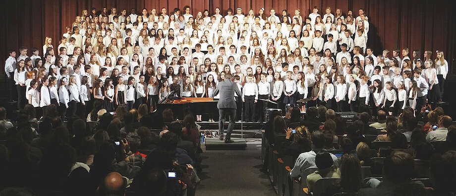 Luke Rosenberg, choral music director, leads elementary school singers Tuesday night at the annual Townwide Choral Festival. Photo: Mike Lauterborn / Westport News