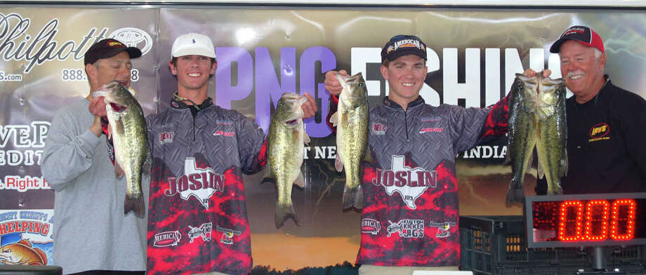 Corrigan-Camden winners Brendon Reavis & Dillon Harrel proudly show the crowd their 1st place catch  Photo by Patty Lenderman, Lakecaster