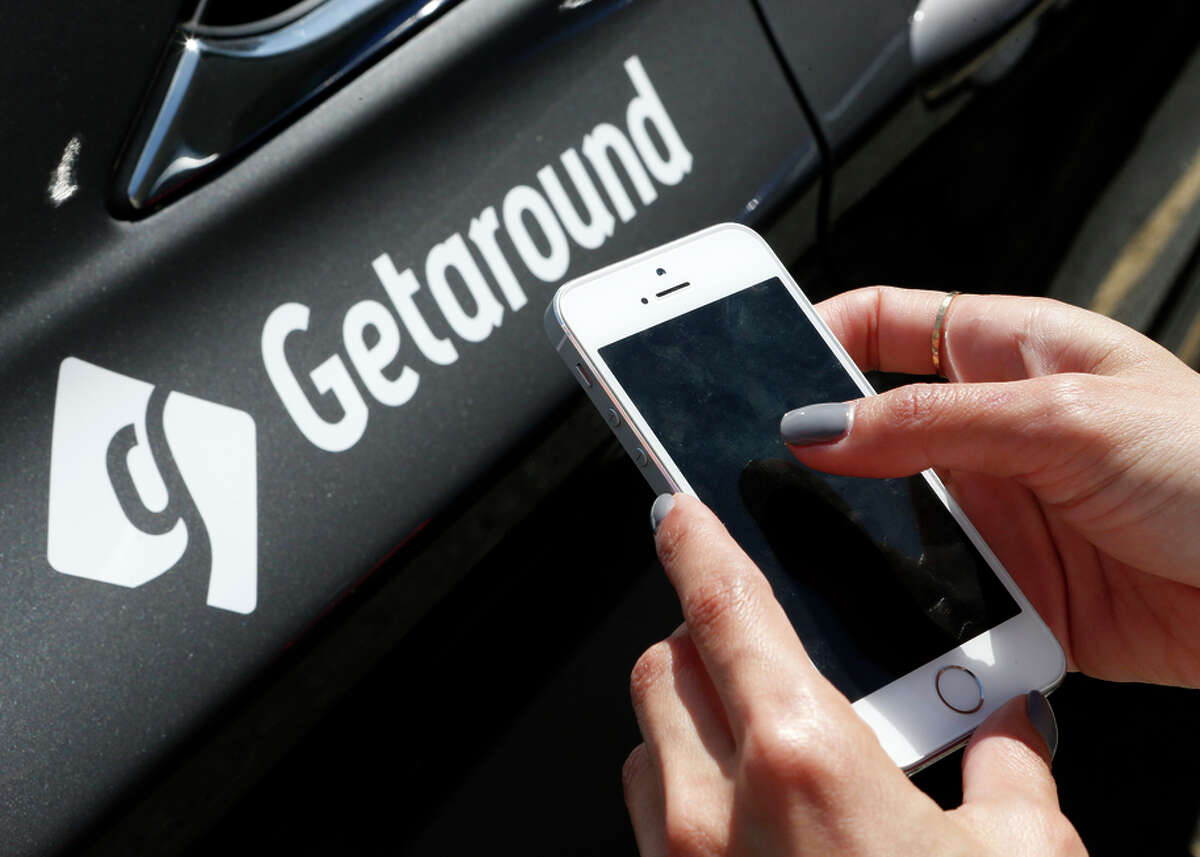 Getaround employee Charlene Foote demonstrates how to rent a car through the company's app last year.
