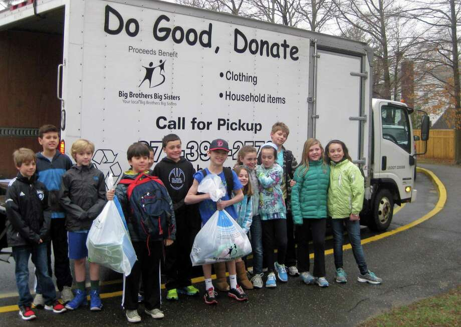 Royle students took spring cleaning to heart this year to fill a truck with gently used clothing, shoes and bedding for Big Brothers Big Sisters of SWCT. In return, the mentoring organization will give Royle $500 to pay for the 10 scholarships Royle School, which has a partnership with the Norwalk/Nagarote Sister City Project. Photo: Contributed Photo, Contributed / Darien News
