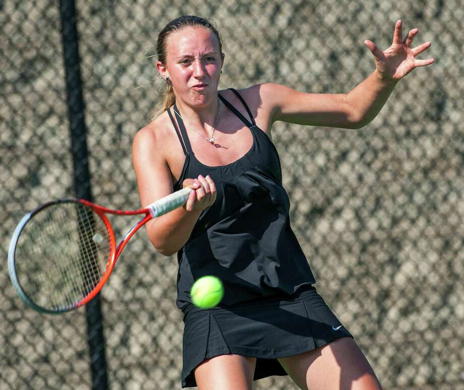 Fairfield Ludlowe high school's Lindsey Evans returns a shot from Staples high school's Melissa Beretta in an FCIAC girls tennis semifinal match played at Fairfield Ludlowe high school, Fairfield, CT on Monday May 20th, 2013. Photo: Mark Conrad / Connecticut Post Freelance